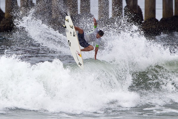 Michel Bourez (PYF), 27, defeated Kelly Slater (USA), 41, securing a Quarterfinals berth at the Vans US Open of Surfing.