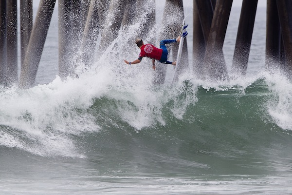 Crews launching a backside air-reverse at the Vans US Open of surfing this season.