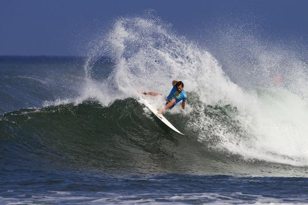 ASP Top 34 member Brett Simpson gouging at Haleiwa, the first stop at the Vans Triple Crown.