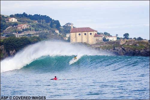 Mundaka certainly has to be one of the most amazing backdrops on the tour – a huge church sits behind the contest setup while steep brown cliffs and green hills silently guard the opening to the river mouth. Not to mention the barreling lefthander... Picture Credit ASP Tostee